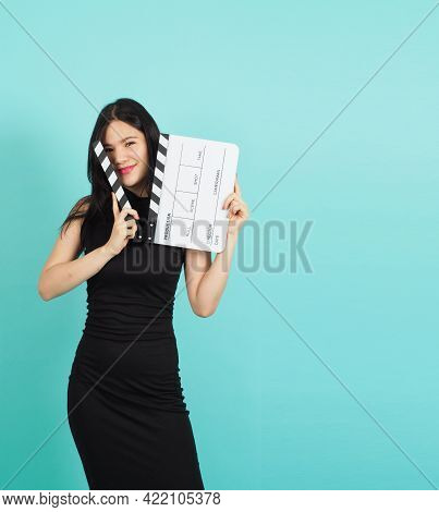Clapper Board Or Movie Clapperboard In Woman Hand With Black Color.it Use In Video Production ,film,