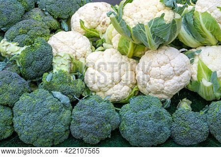 Broccoli And Cauliflower For Sale At A Market