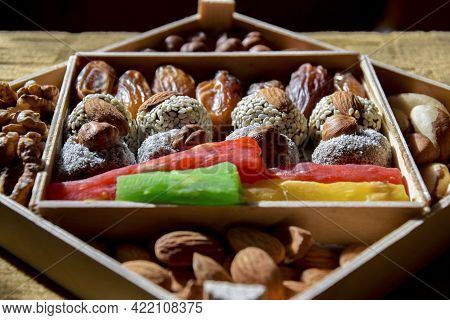 Colorful Set Of Nuts And Dried Fruits In Wooden Package. Healthy Eating Concept. Almonds, Hazelnuts,