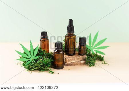 Various Glass Bottles Of Cbd Oil, Thc Tincture Over Modern Background. Cosmetics Cbd Oil. Droplet Bo