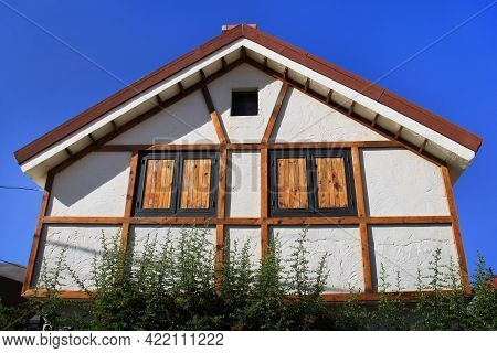 A Half-timbered House Against A Blue Sky In Lebanon.