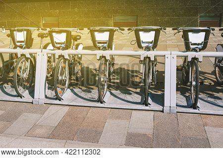 Bicycle Rental On The Street. Urban Transport For Getting Around The City. Bicycle Rental For Travel