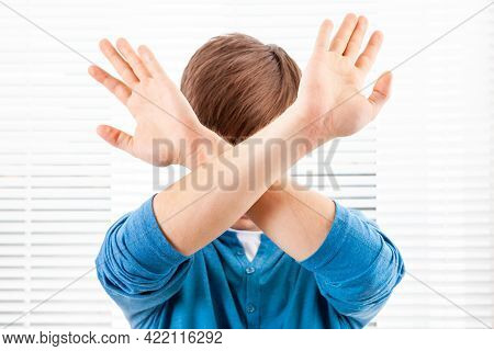 Man Show A Refusal Gesture On The Jalousie Background In A Room