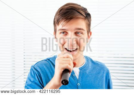 Guy With A Microphone Sing A Song On The Jalousie Background