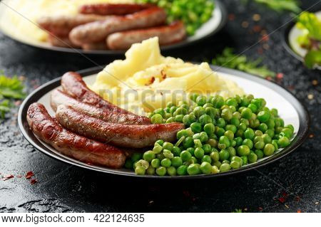 Pork Chipolata Sausages With Home Cooked Mashed Potato And Green Peas