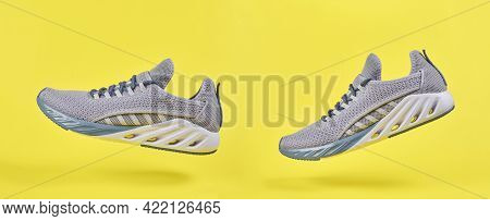 Gray Sport Shoes For Running On Yellow Background. Concept Healthy Lifestyle, Sport And Fitness. Col