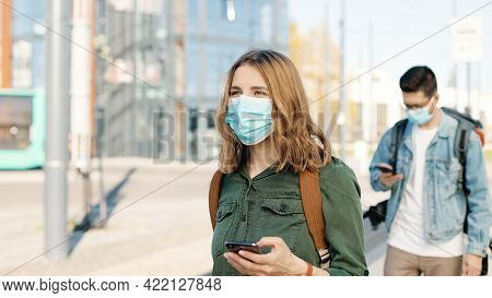 Portrait Of Caucasian Travelers In Masks On Street Passing Health Control Showing Vaccination Digita