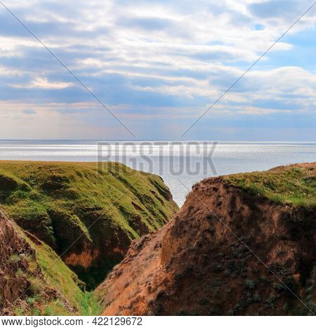 Landscape View Clay Cape Mountains And Cliffs Near Blue Sea And Skyline. Seascape Of Coast From Gree