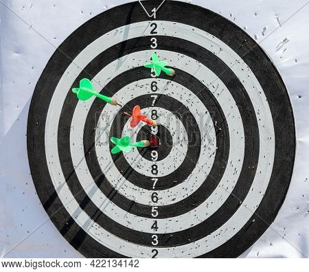 Darts. Darts Stick Out At The Target. Darts Is A Game In Which Players Throw Darts At A Round Target