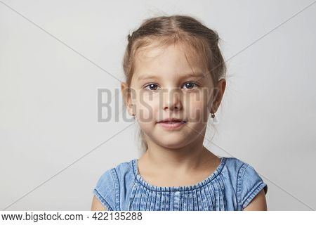 Happy Child Girl Portrait On A White Background With Copy Space