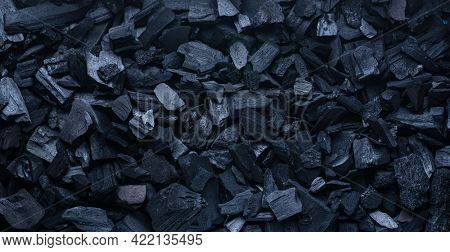 Natural black coals close up. Top view picture.
