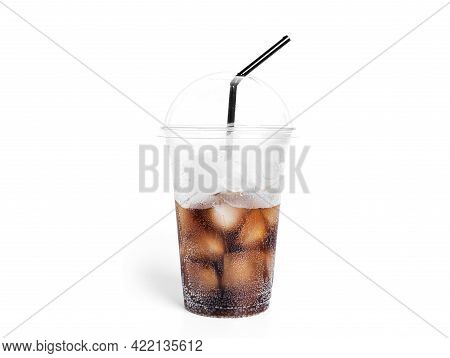 Soda With Ice In A Transparent Plastic Glass Isolated On A White Background.