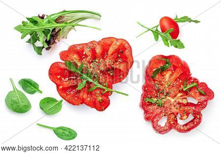 Creative Layout Made Of Heirloom  Tomato Isolated On White Background. Flat Lay. Food Concept. Fresh