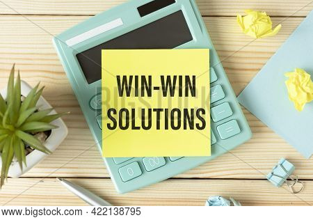 Text On Notepad Win-win Solutions On Calculator White Table.