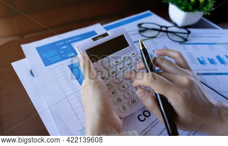Close Up Businesswoman Holding Calculator And Press On The Button. Business Financial Accounting Con