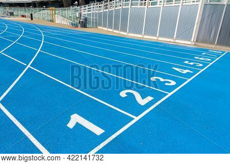 Starting Line For The Race Inside A Stadium With The 8 Starting Blocks