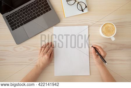 Woman Writing To Do List Or Organizing Plans On Empty Sheet Of Paper, Holding Pen, Top View, Flat La