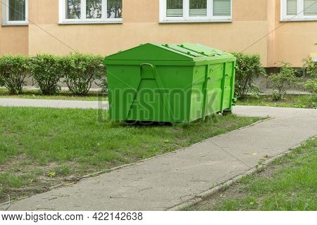 Covered Container For Construction And Household Waste. Metal Container With A Lid. Solid Waste Bin.