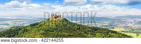 Panoramic View Of Hohenzollern Castle On Mountain Top, Landscape With German Burg Like Medieval Cast