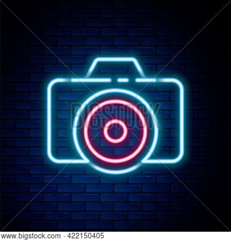 Glowing Neon Line Photo Camera Icon Isolated On Brick Wall Background. Foto Camera Icon. Colorful Ou