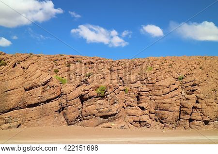 Amazing Rock Formations With Growing Unique Desert Plants Called Yareta Along The Road In Siloli Des