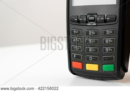 Pos Terminal Or Credit Card Reader Machine On The White Table With Copy Space.