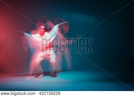 Contemporary Hip Hop Dance. Cool Dancing Modern Girl Moving In Colorful Neon Studio Light. Long Expo