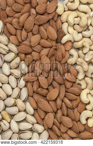 Nuts Background, Top View. The Natural Background Is Made From Different Varieties Of Nuts