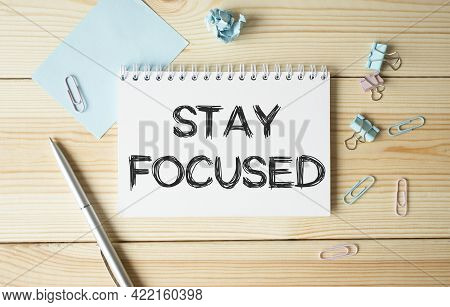 Stay Focused Text On Notebook On Wooden Background