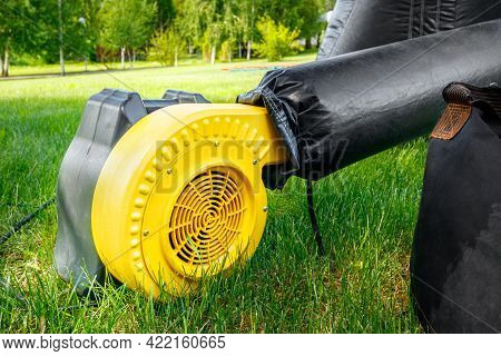 Yellow Electric Air Blower Pump For Commercial Inflatable Bouncer Or Trampoline Outdoor.