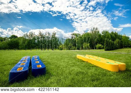 Preparation Teambuilding Exercises With Fun Ski On The Grass. Concept Of Summer Team Building With C
