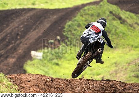 A Motorcycle Racer Loses His Balance In A Jump From An Obstacle. Selective Focus.