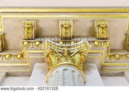 Close-up Decorative Gold Stucco On The Ceiling Fillet In Luxurious Expensive Interior Of A Large Bar