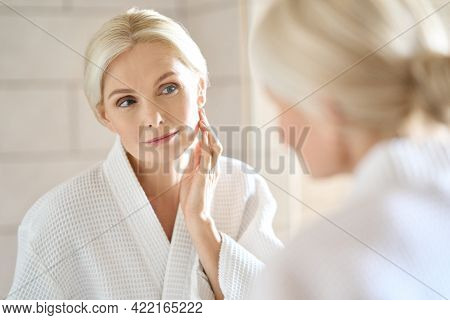 Headshot Of Gorgeous Mid Age Adult 50 Years Old Blonde Woman Standing In Bathroom After Shower Touch