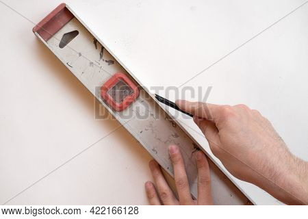 Man Repair Worker Checking Level Of The Wall With The Bubble Level Tool. Renovation Apartment Concep