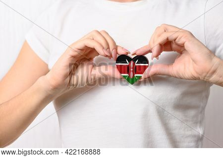 Flag Of Kenya In The Shape Of A Heart In The Hands Of A Girl. Love Kenya. The Concept Of Respect For