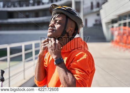 Courier Man Taking On His Helmet While Preparing To The Road To The Client