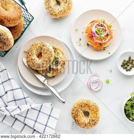 Top Down View Of Everything Bagels Topped With Cream Cheese, Smoked Salmon Lox And Garnished With Ca