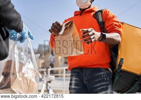Male Courier Wearing Medical Mask Delivering Grocery Order