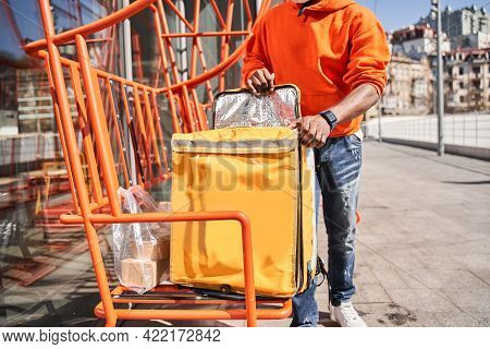 Courier Carrying The Bag With Take Away Food And Beverages