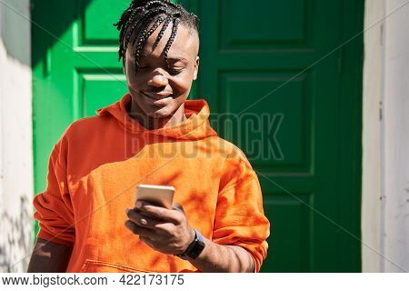 Delivery Man Using Smartphone Outdoors After The Delivering Order