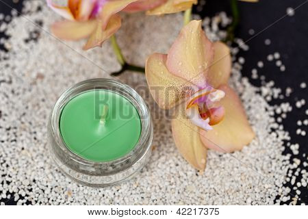 Sand, Orchid flower and Candle. Close up. poster
