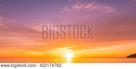 Landscape Long Exposure Of Majestic Clouds In The Sky Sunset Or Sunrise Over Sea With Reflection In