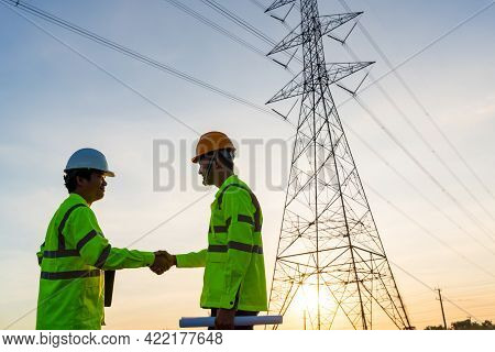 Team Work Of Engineers And Technician Handshake After Work Inspections At The Electric Power Station