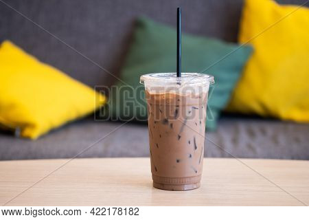 Iced Mocha Coffee In Plastic Cup Showing The Texture And Refreshing Look Of The Drink With Sofa Back