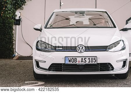 Wolfsburg, Germany - June 19, 2016: Volkswagen Vw E-golf Electric Car On The City Streets. Charge Ca
