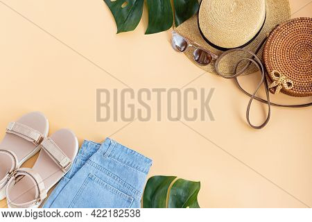 Summer Composition With Female Fashion Outfit. Monstera Leaves, Straw Hat, Bamboo Bag, Shoes, Wirele