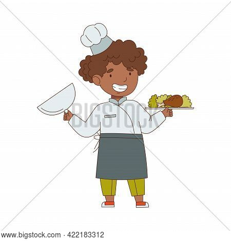 Little African American Girl Chef In White Toque And Jacket Holding Tray With Served Appetizing Meal