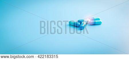 Blue Capsule Pills On Blue Background. Pharmacy Shop Banner. Pharmaceutical Industry. Antibiotic Cap