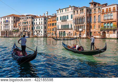 Venice, Italy - May 25 2018: Three Gondolas Carrying Tourists On The Grand Canal. Scenic Venetian La